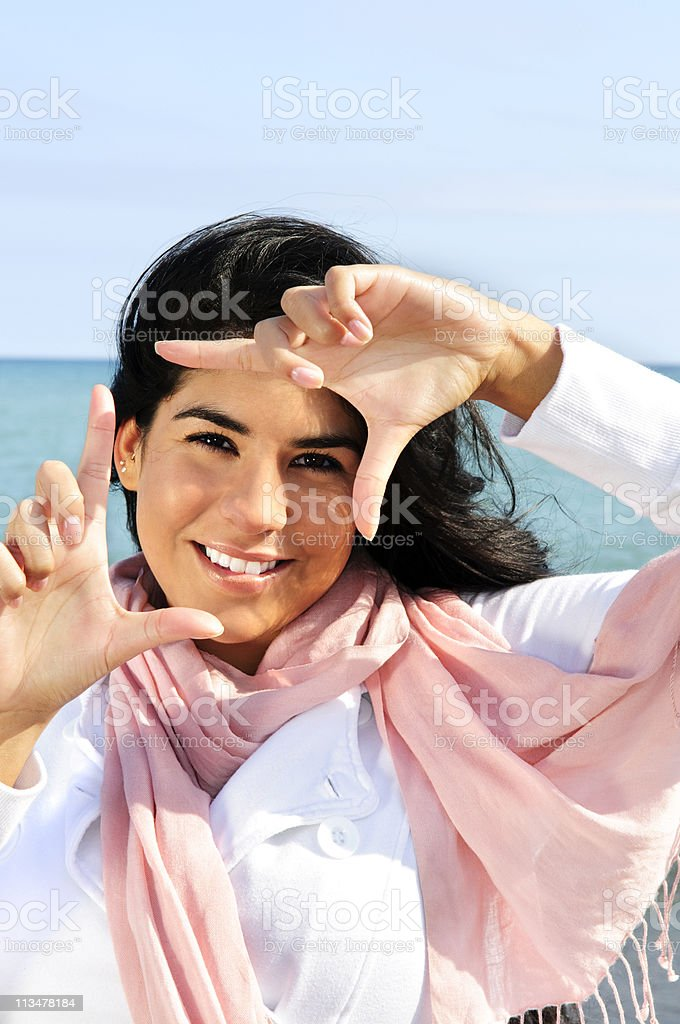 Beautiful young woman framing her face royalty-free stock photo