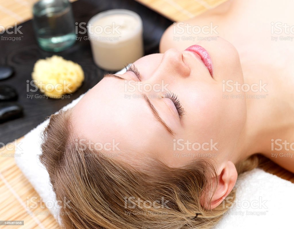 Beautiful young woman getting face massage at day spa royalty-free stock photo