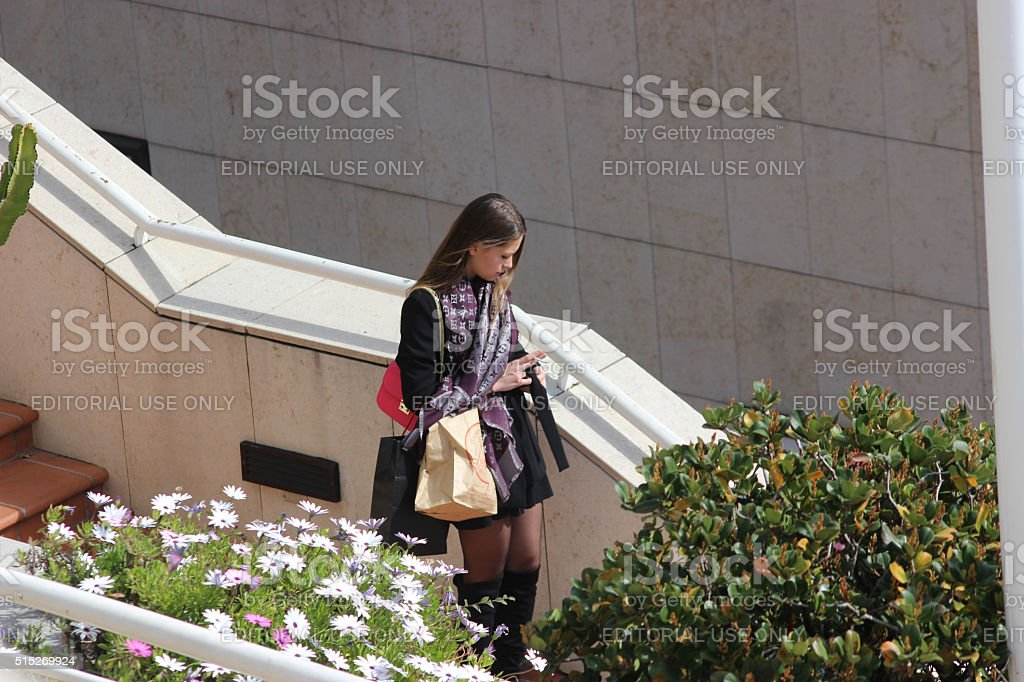 Beautiful Young Woman Goes Shopping in Monaco stock photo