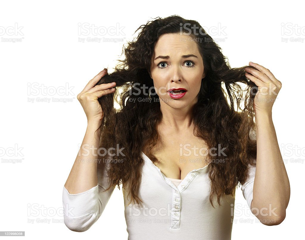 Beautiful young woman having a bad hair day stock photo