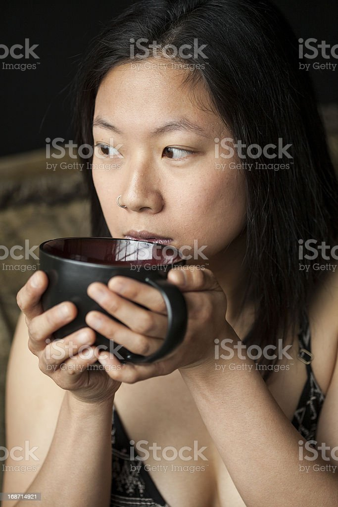 Beautiful Young Woman Holding a Black Coffee Cup royalty-free stock photo
