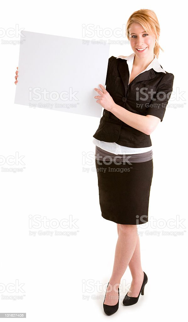 Beautiful Young Woman Holding a Blank White Sign royalty-free stock photo