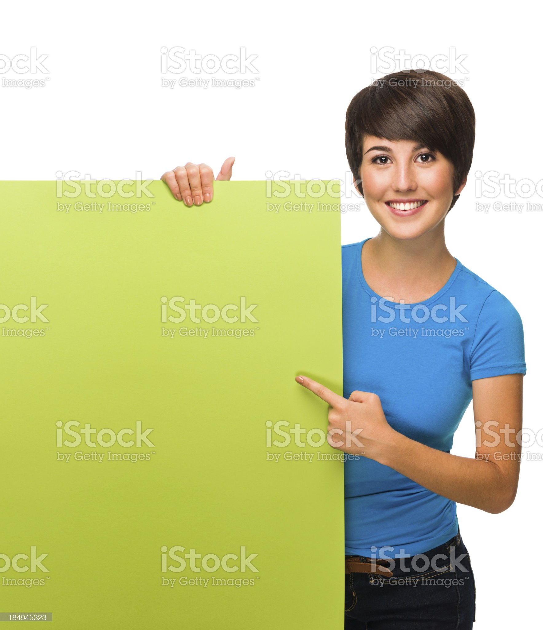 Beautiful young woman holding a sign royalty-free stock photo