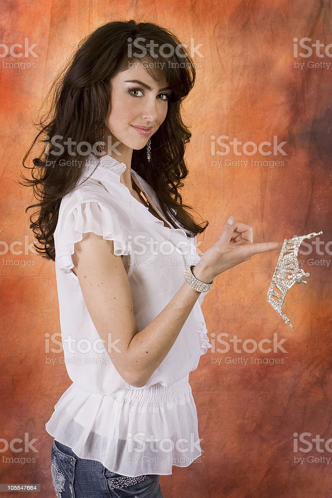 Beautiful Young Woman holding Beauty Crown stock photo