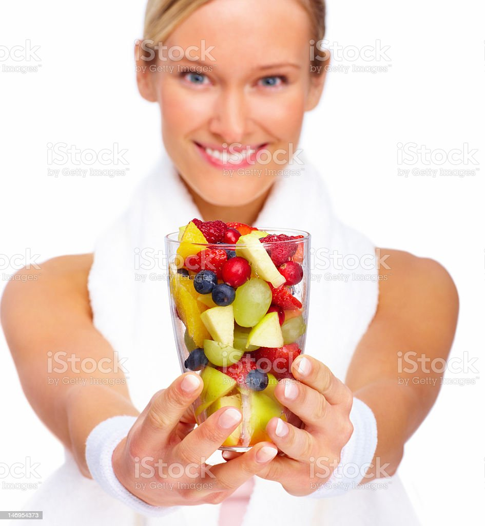 Beautiful young woman holding bowl of salad royalty-free stock photo