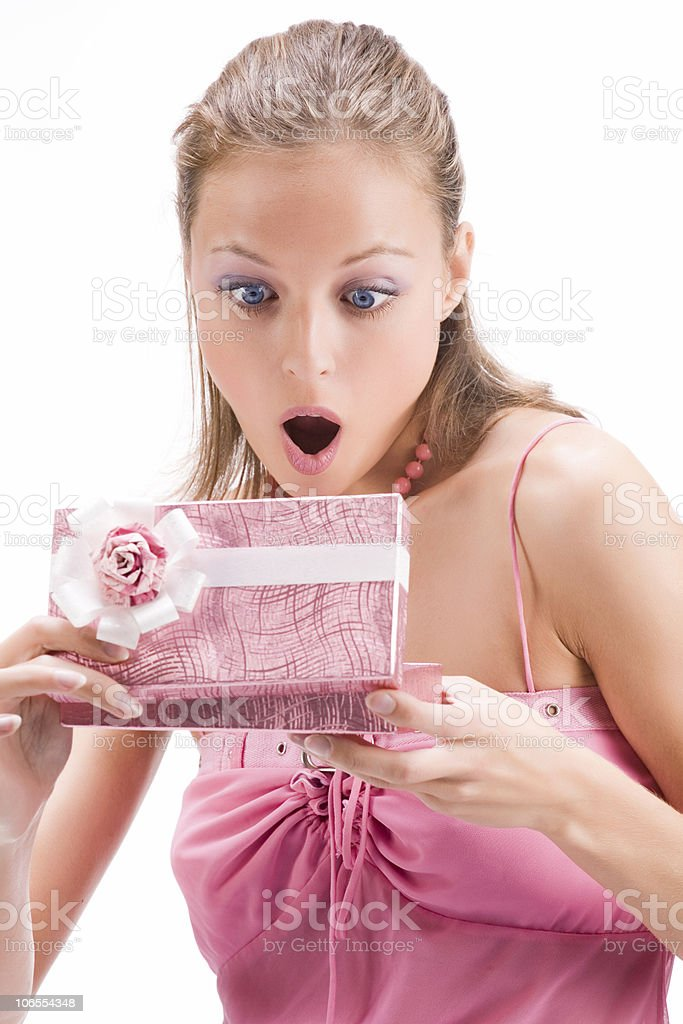 Beautiful young woman holding boxed gift royalty-free stock photo
