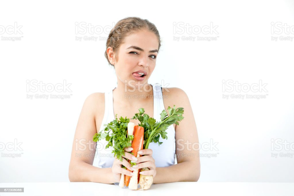 Beautiful young woman holding healthy food in hands on the light background stock photo