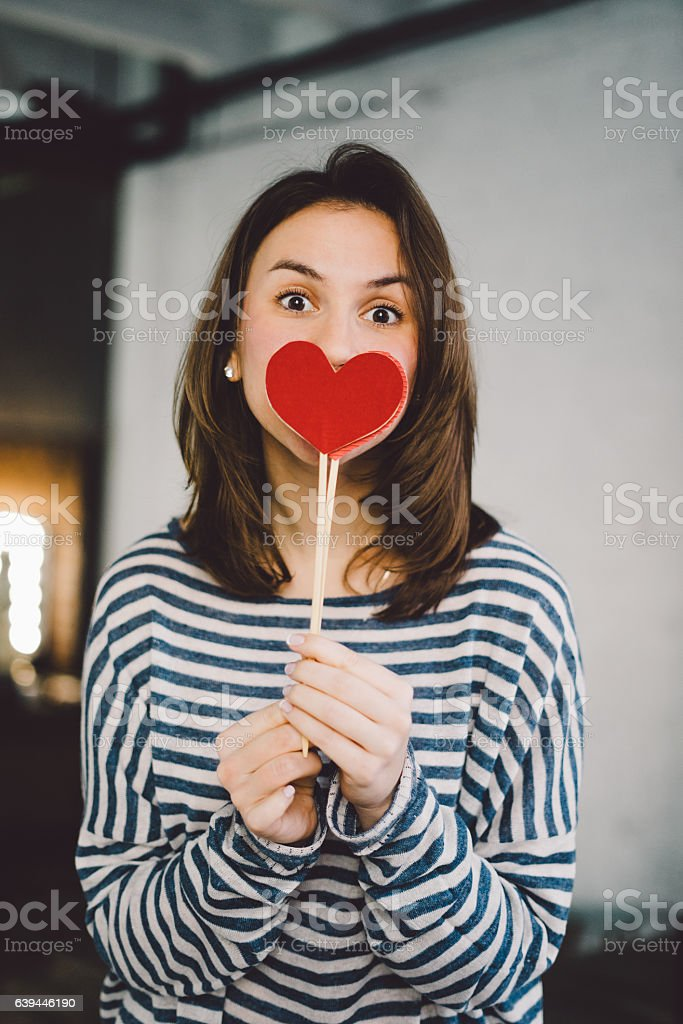 Beautiful young woman holding paper hearts stock photo