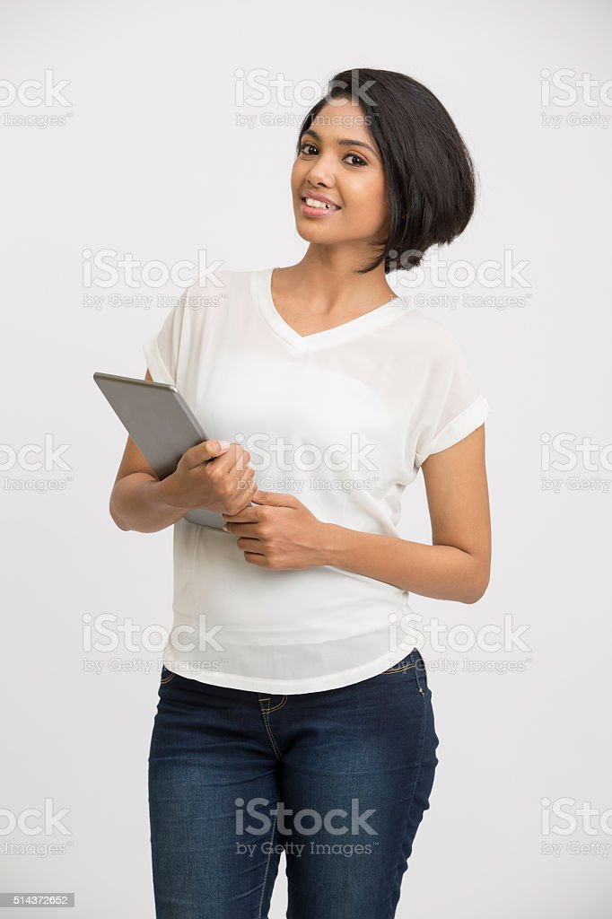 Beautiful young woman holding tablet computer stock photo