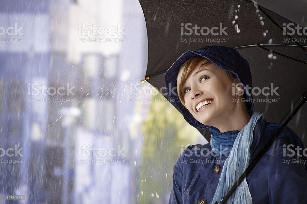 Beautiful young woman holding umbrella stock photo