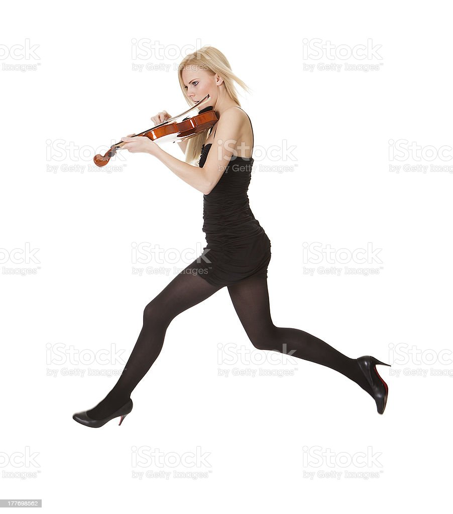 Beautiful young woman holding violin royalty-free stock photo