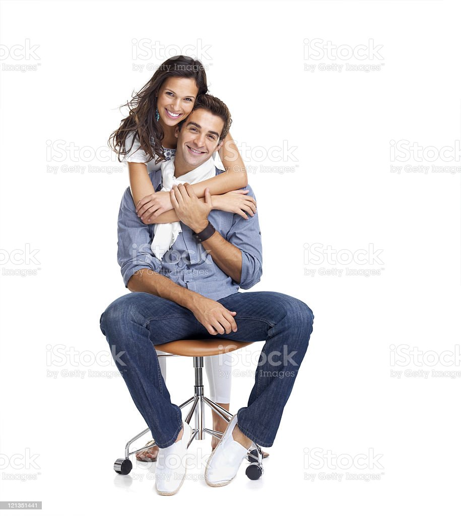 Beautiful young woman hugging her boyfriend on white royalty-free stock photo