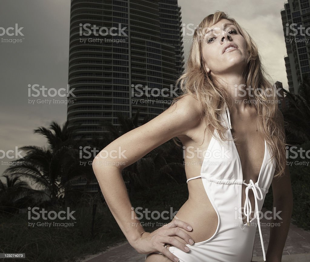 Beautiful young woman in a bathing suit stock photo