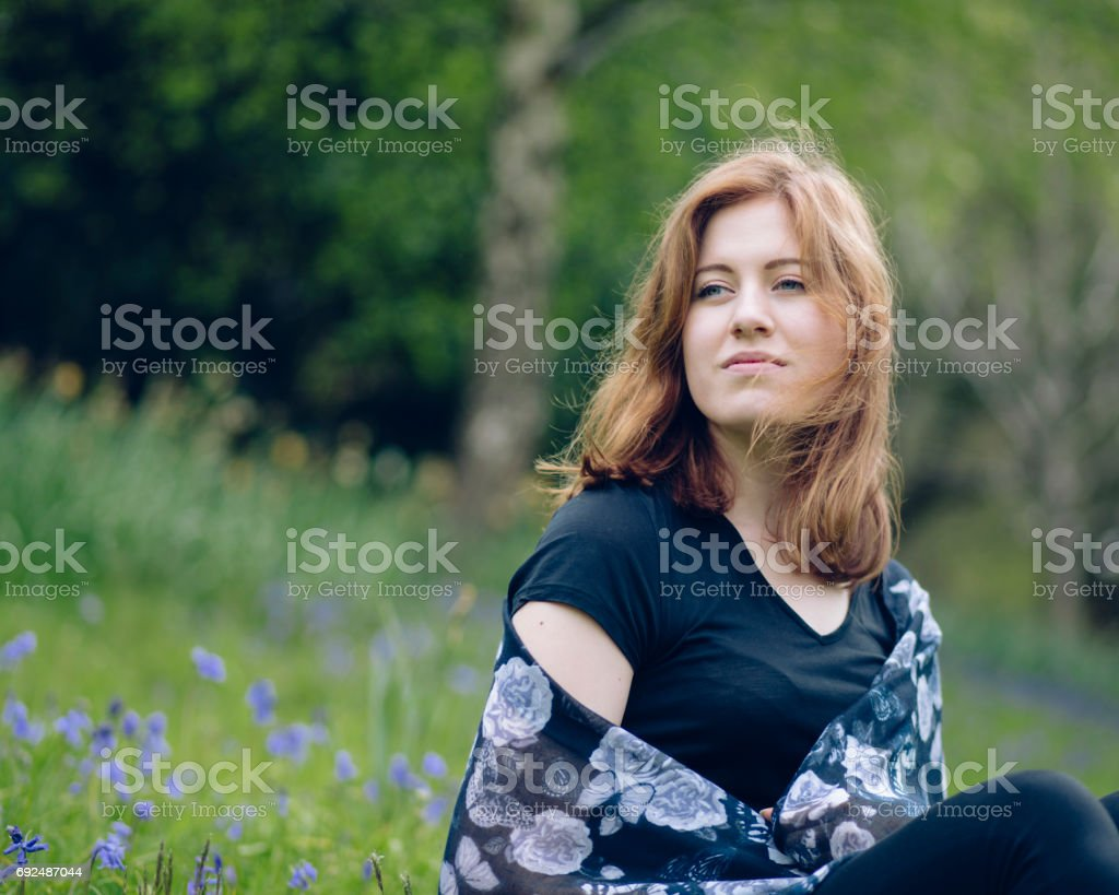 Beautiful young woman in a country park stock photo
