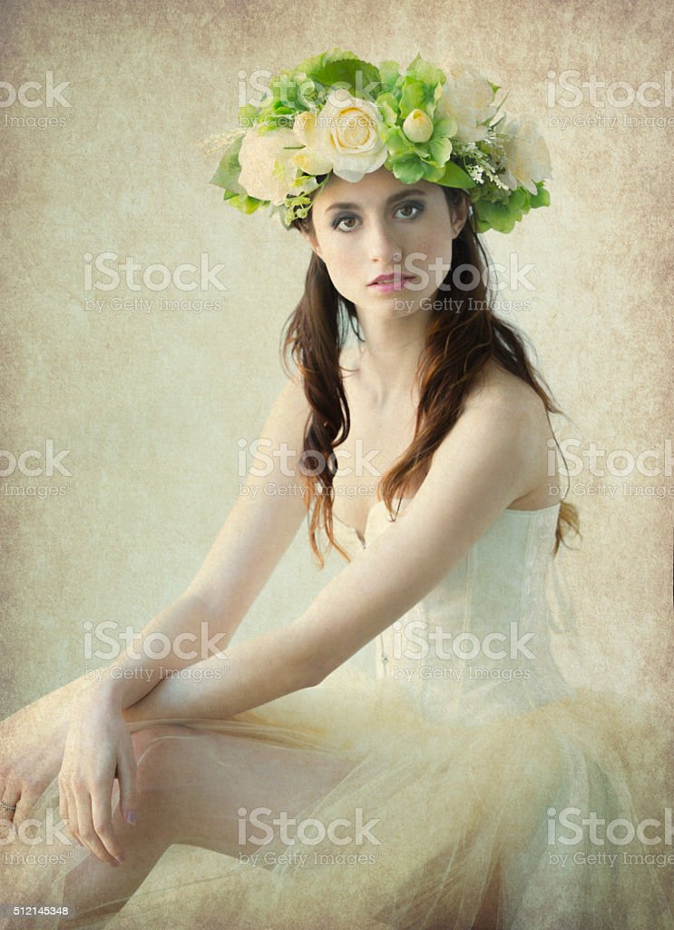 Beautiful Young Woman in a Flower Crown stock photo
