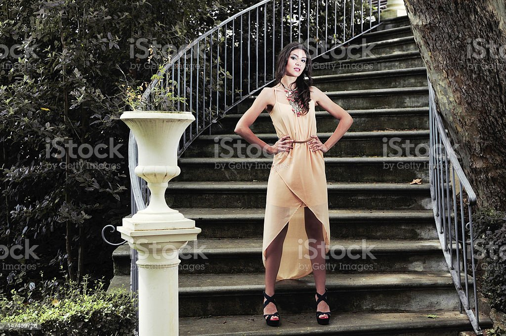 Beautiful young woman in a garden stairs royalty-free stock photo