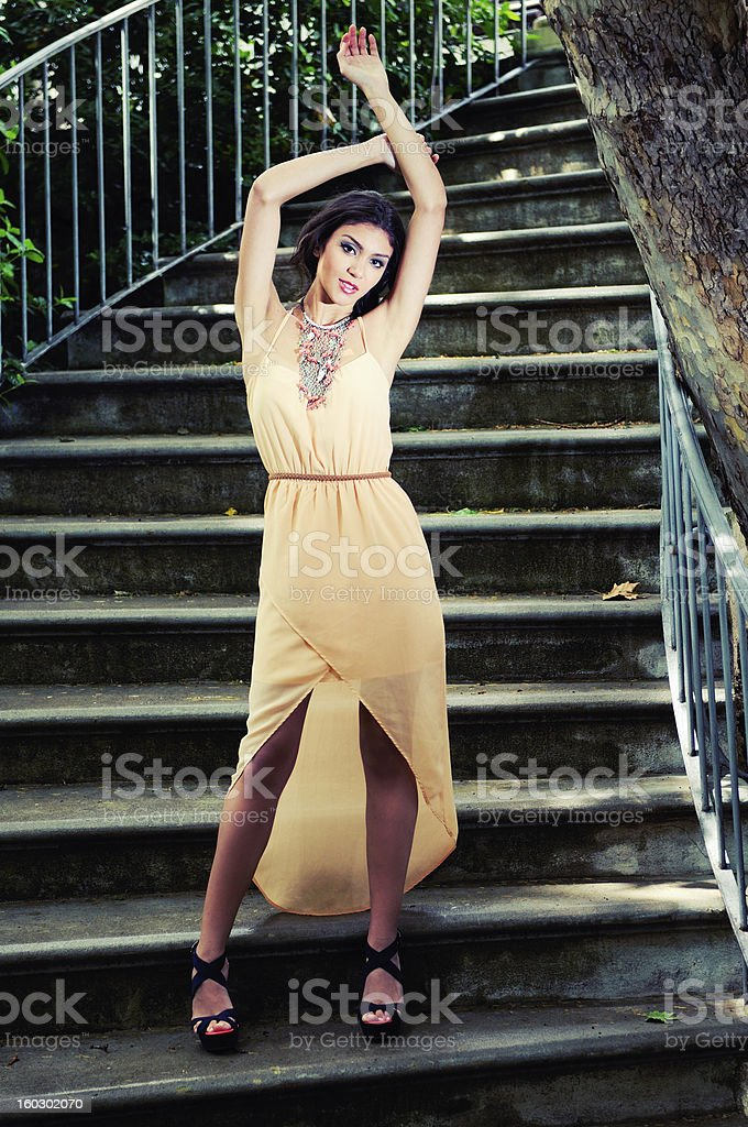 Beautiful young woman in a garden stairs stock photo