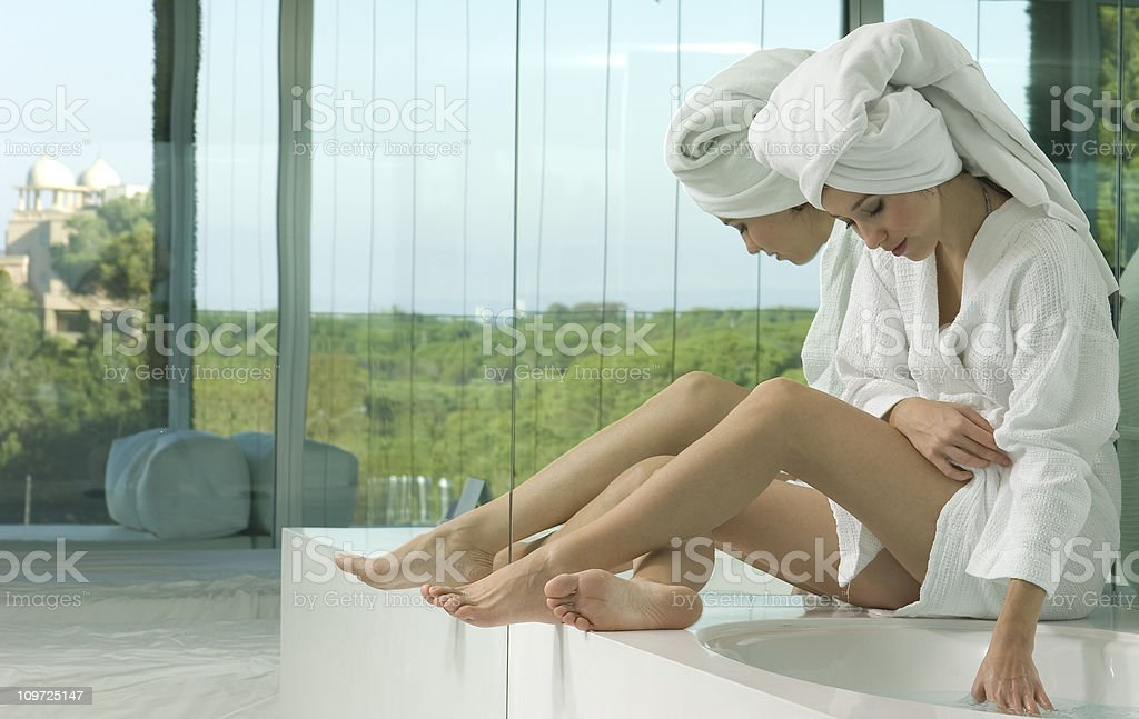 beautiful young woman in bathroom royalty-free stock photo