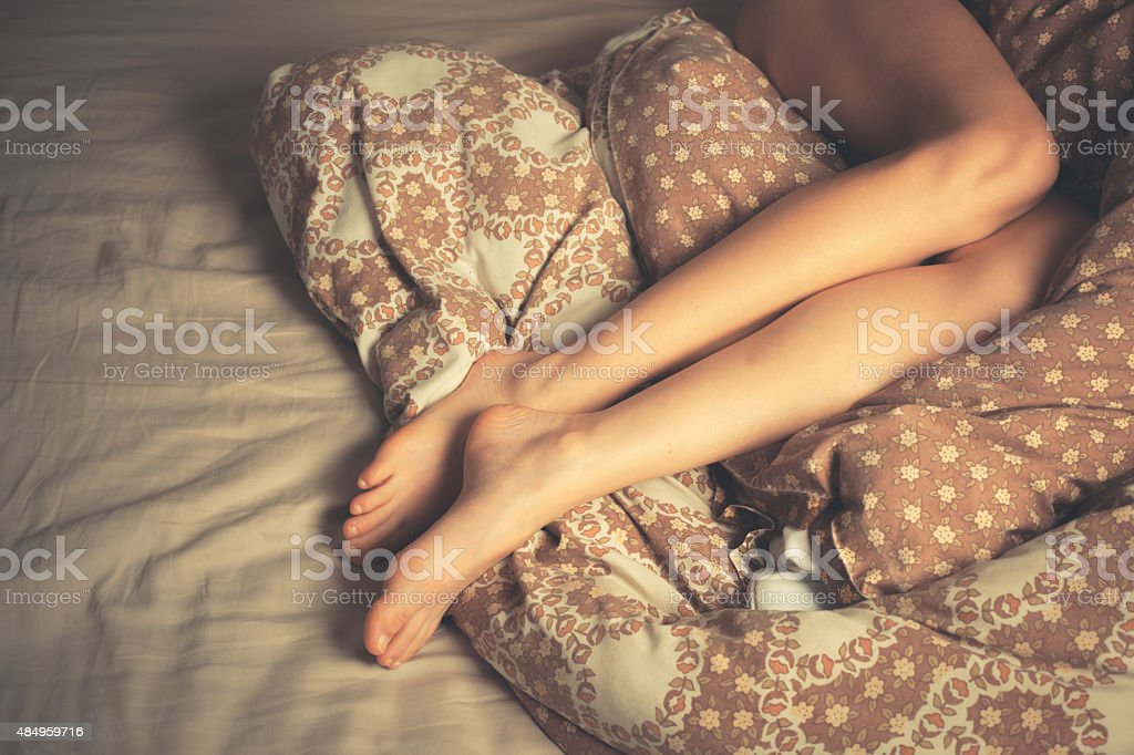 Beautiful young woman in bed stock photo