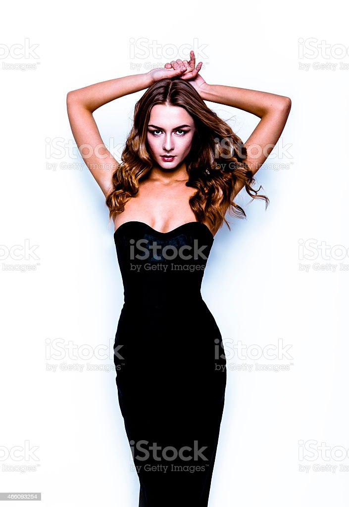 Beautiful young woman in black dress stock photo