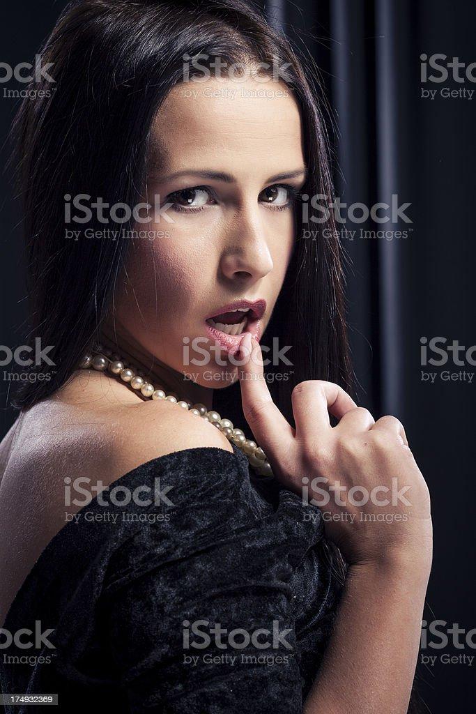 Beautiful young woman in black dress posing royalty-free stock photo