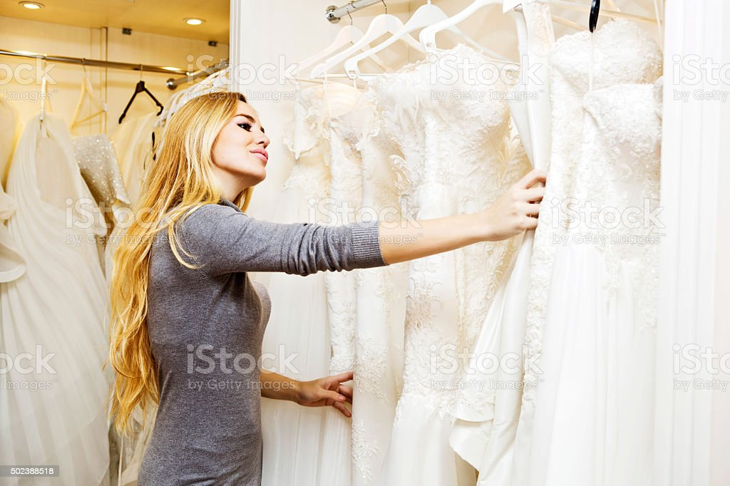 Beautiful young woman in bridal boutique stock photo