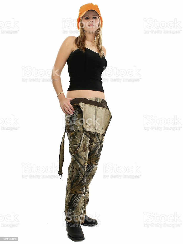 Beautiful young woman in camo overalls and tank royalty-free stock photo