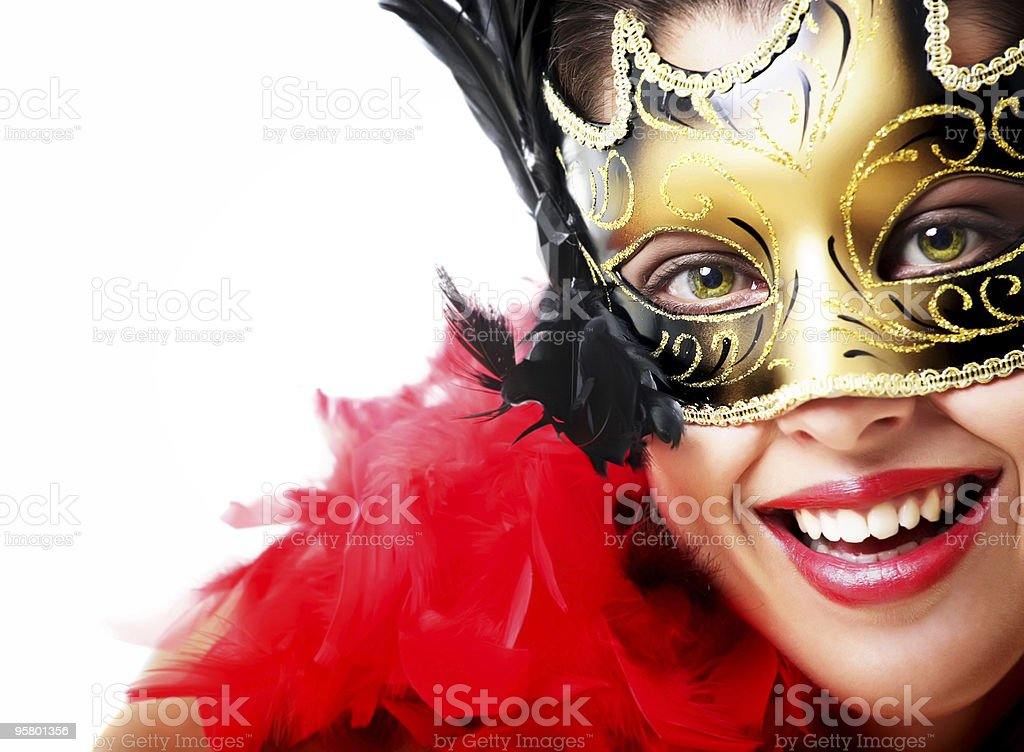 Beautiful young woman in carnival mask and feather boa royalty-free stock photo