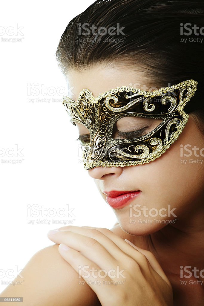 Beautiful young woman in carnival mask royalty-free stock photo