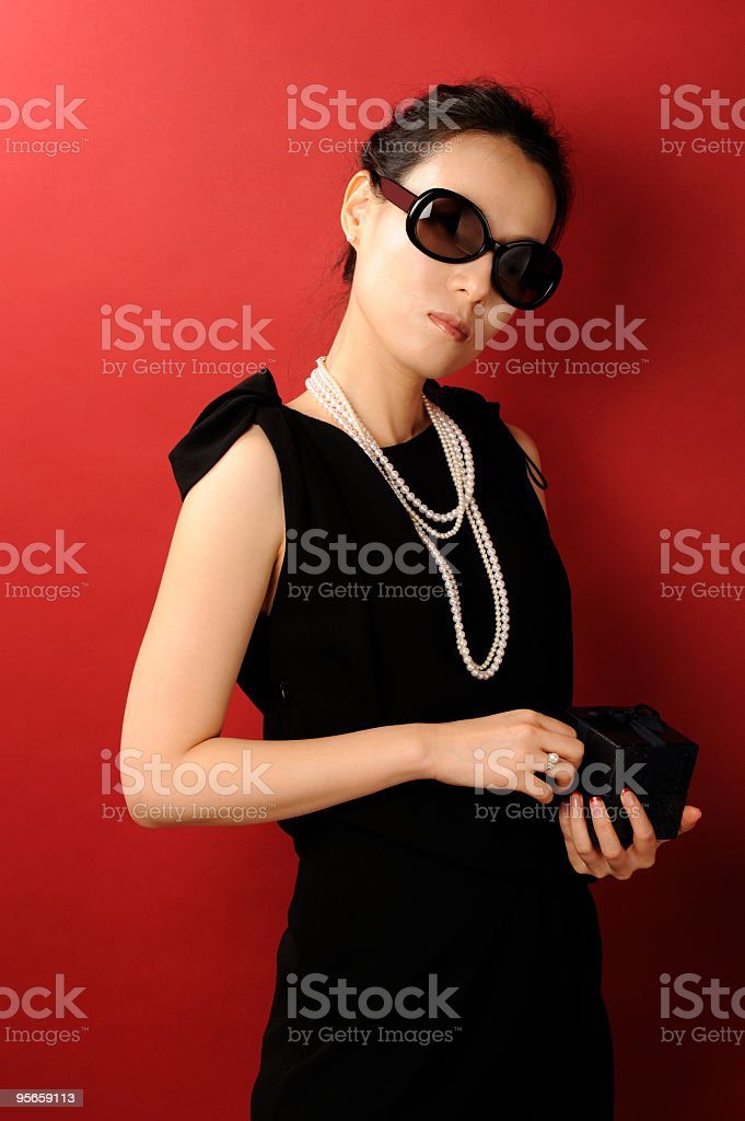 Beautiful young woman in cocktail dress stock photo