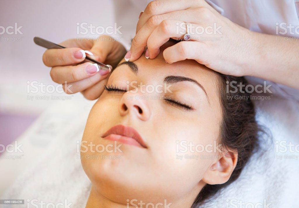 Beautiful young woman in cosmetic salon stock photo