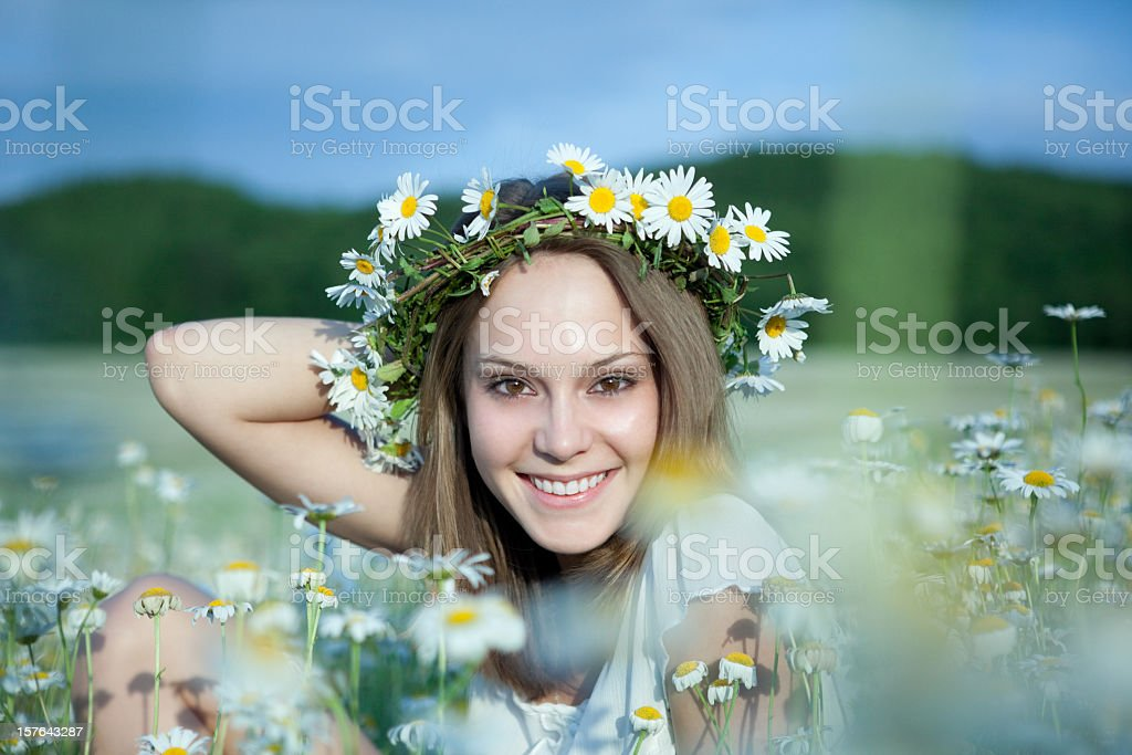 Beautiful young woman in daisies stock photo