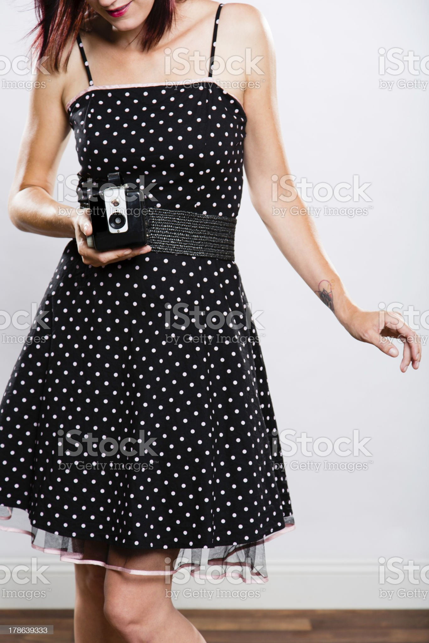 Beautiful young woman in dress with camera royalty-free stock photo