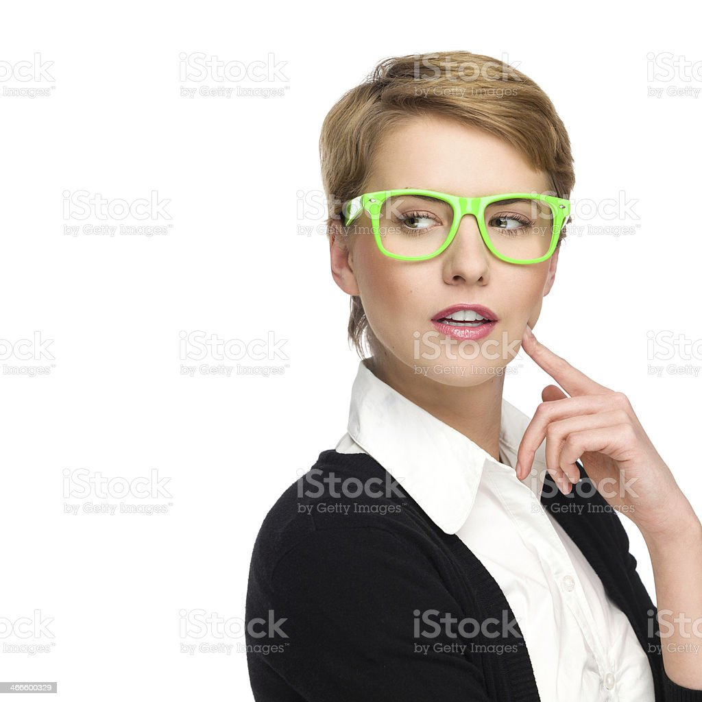Beautiful young woman in green glasses looking at copy space. stock photo