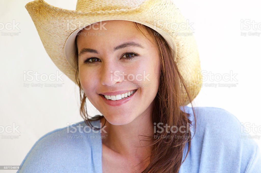 Beautiful young woman in hat smiling stock photo