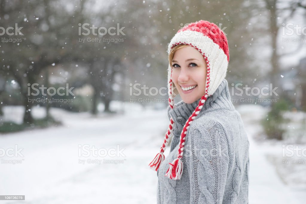 Beautiful Young Woman in Knit Cap on Snowy Day, Copyspace royalty-free stock photo