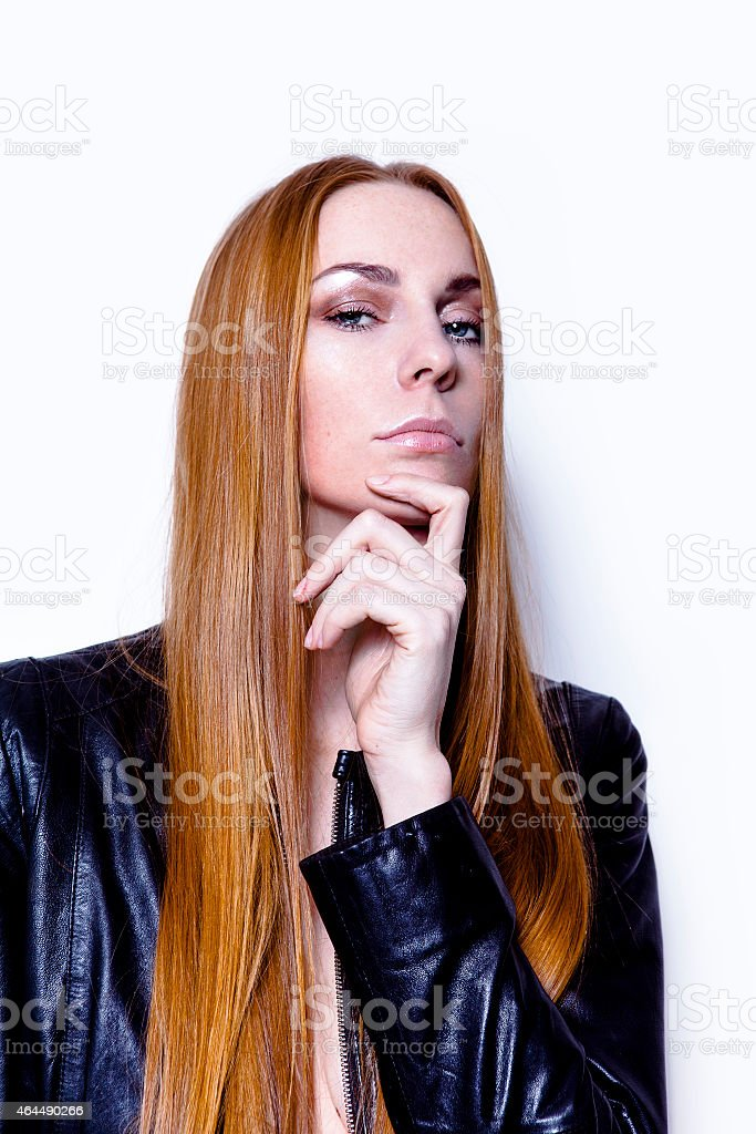 Beautiful young woman in leather jacket stock photo