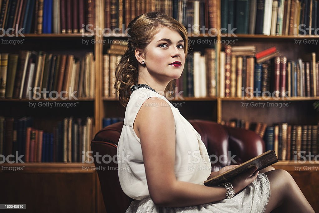 Beautiful young woman in library royalty-free stock photo