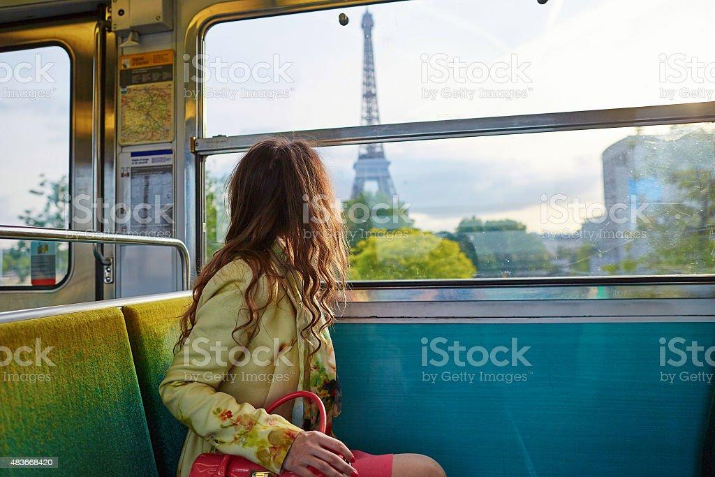 Beautiful young woman in Parisian metro stock photo
