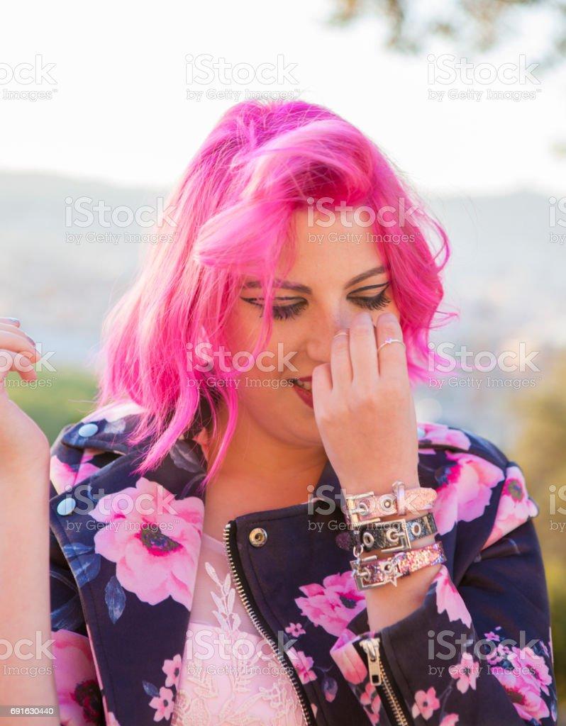 Beautiful young woman in pink flirting stock photo