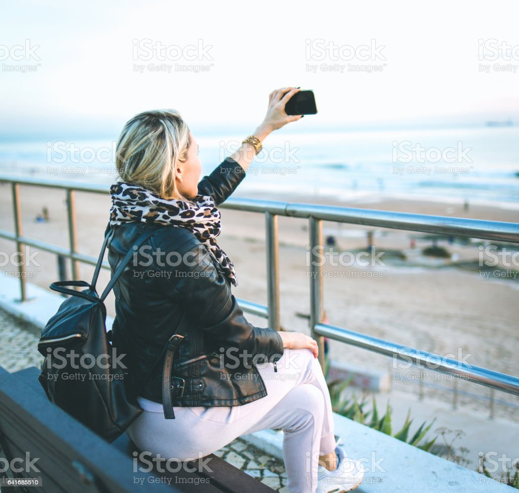 Beautiful young woman in real life, she making selfie stock photo