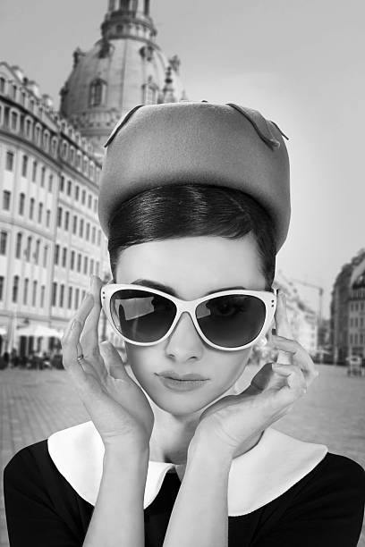 Beautiful young woman in retro style in old town stock photo