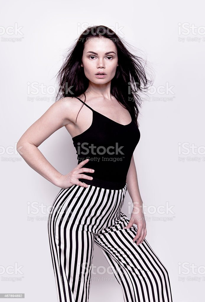 Beautiful young woman in stylish clothes stock photo