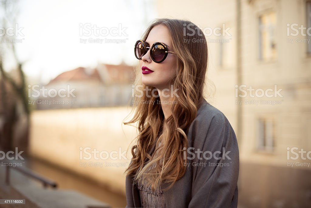 Beautiful young woman in sunglasses in the city stock photo