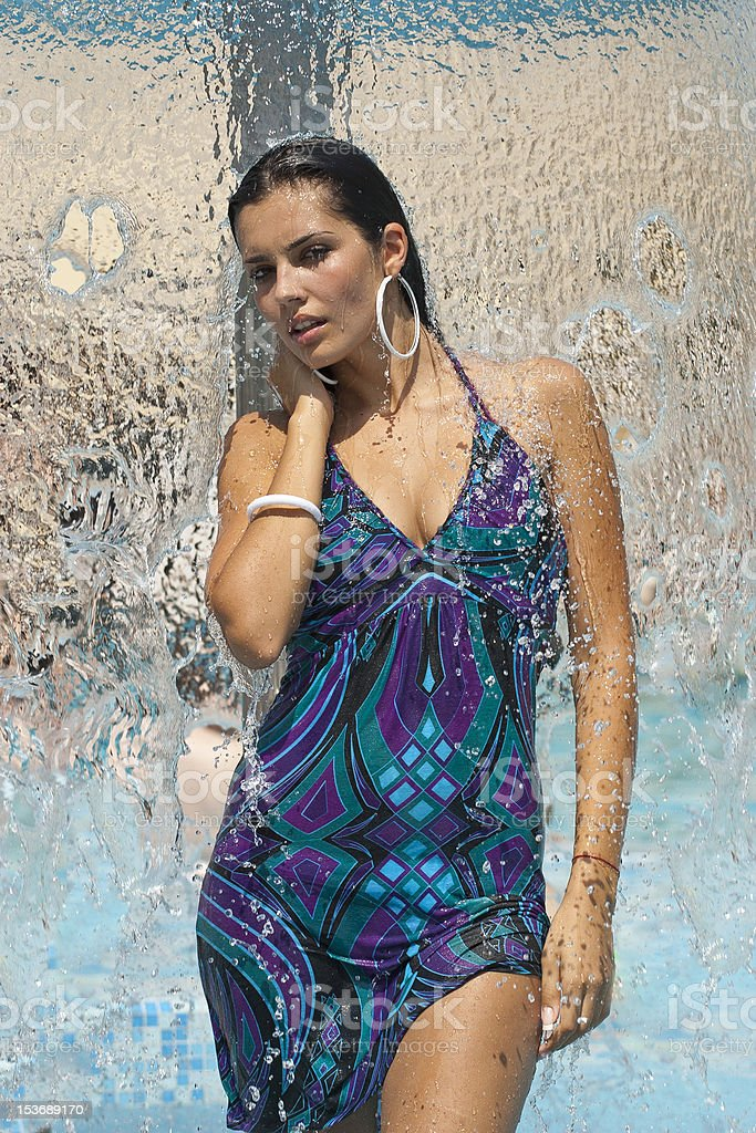 beautiful young woman in swimming pool royalty-free stock photo