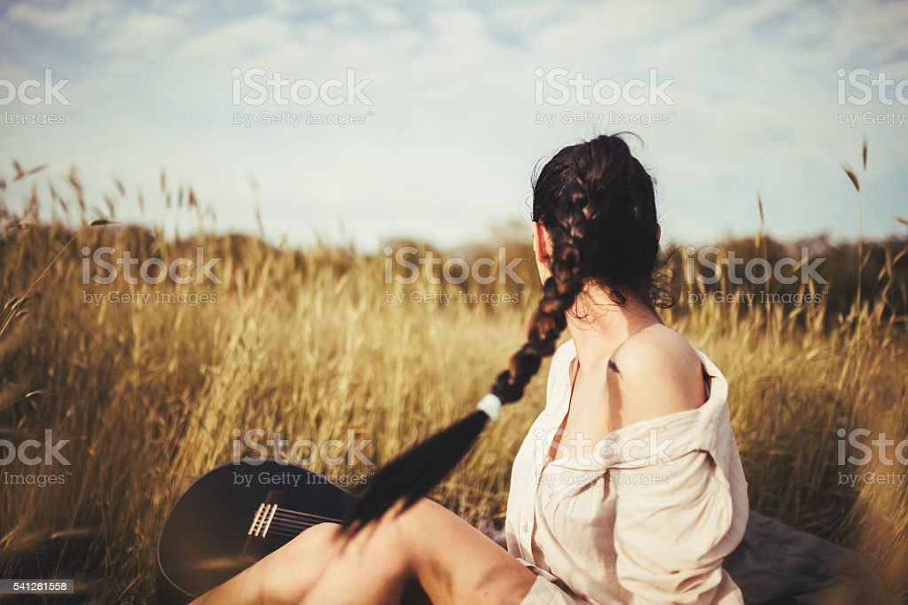 beautiful young woman in the field stock photo