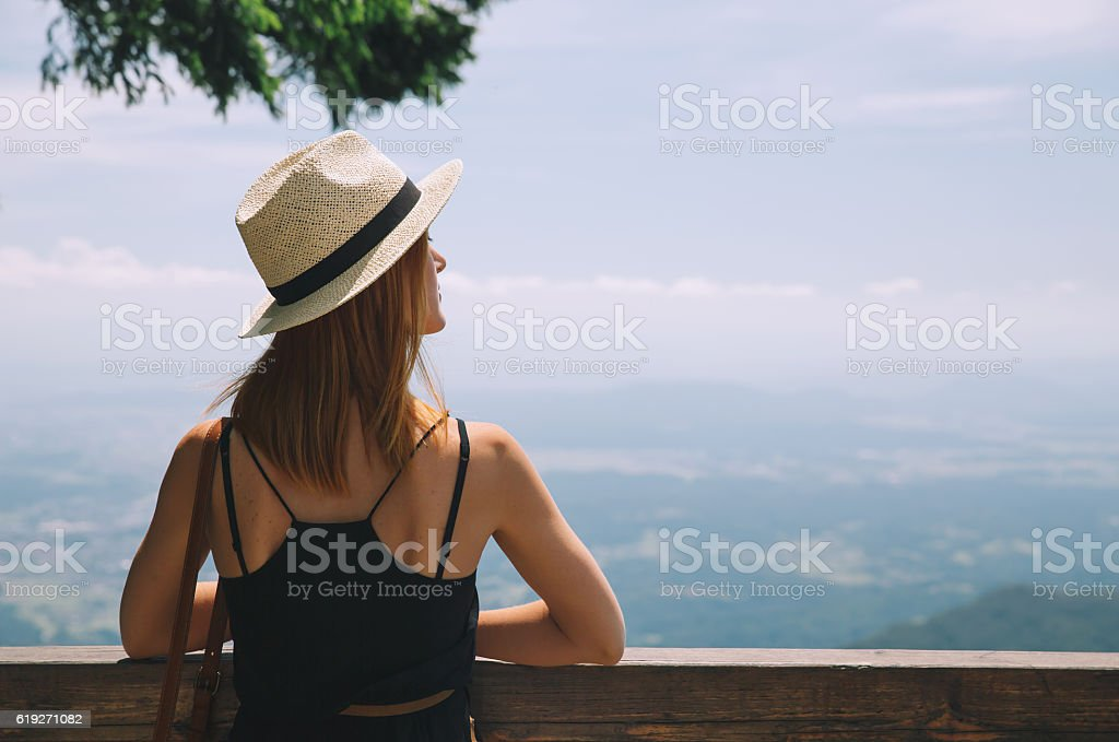Beautiful young woman in the mountains. stock photo