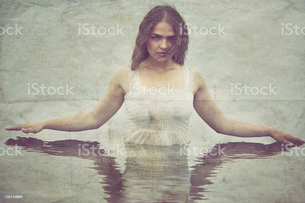 Beautiful Young Woman in the Water. stock photo