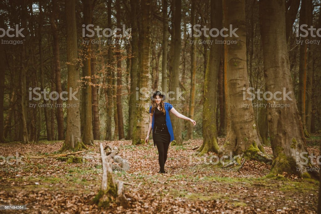 Beautiful young woman in the woods stock photo