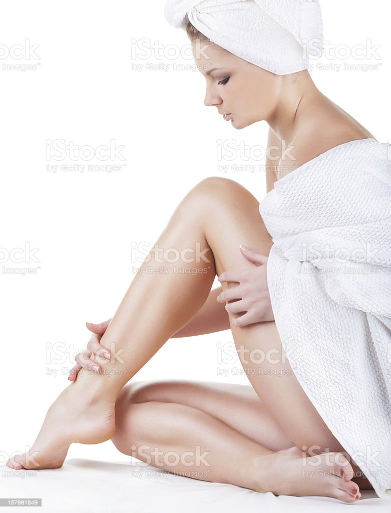 Beautiful young woman in towel stock photo